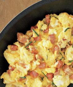 Eggs With Ham, Cheddar, and Chives | Start the day with protein-packed recipes that will leave you satiated and energized for hours.