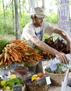 Serenbe, GA - the New Utopia - man organizing vegetables for sale at a farmer's market