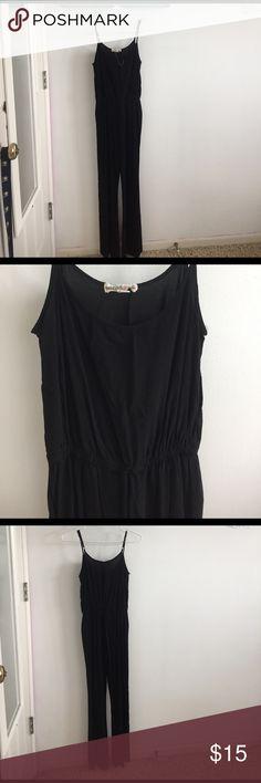black jumpsuit Black jumpsuit. Adjustable straps. Pockets. Legs flare out slightly. Elastic around the waist. Pants Jumpsuits & Rompers