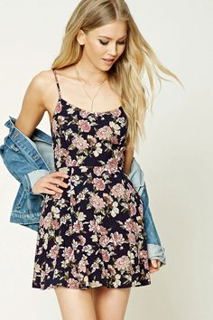 Style Deals - A woven dress featuring an allover floral print, sleeveless cut, a lace-up back, adjustable straps, round neckline, a concealed side zipper, and a skater silhouette.