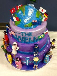 3 tier cake, inspired new church opening. The world is rice crispy treat, the cakes are strawberry, chocolate and vanilla/white. Flags are paper and toothpicks, figurines are real toys.