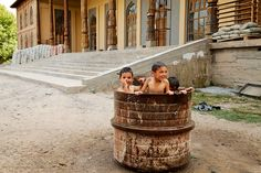https://flic.kr/p/aozxAa | Playing outside the mosque | Three Tajik boys play in a barrel of water in front of Gharm's main mosque on July 13, 2011