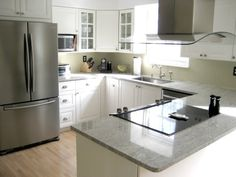 gray granite with white cabinets