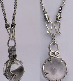 €102 Gotland ball 20 mm with chain    Viking crystal ball pendant, handmade in silver and rock crystal. This pendant is a copy of a viking ball  found at Gotland, Sweden. The original pendant is part of the viking exhibition at the historical museum of Gotland, Sweden. It dates back to the 11th Century. The wolfchain is designed by Stig Nielsen. The wolf is said to be an important animal for the vikings, symbolizing protection.    Size of ball: 20 mm    Lenght of chain: 52 mm    Silver 925…