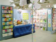 LOVE it all! Such a cheerful + inviting space. The raindrop garlands are such a fun touch! {craft booth setup}