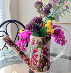 So pretty!  Turn an old veggie can an paper towel tube into a darling décor-only watering can!  Would likely be a fab Mother's Day gift too!