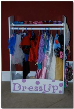 Dress Up Center.  Don't get me wrong, this is a super cute idea.  But years of experience have taught me that children don't hang anything on hangers.  Ever.