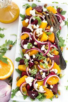 Beet Salad with Goat Cheese and Orange Vinaigrette also has red onion, and a sprinkling of pistachios. I like it on a bed of baby arugula.