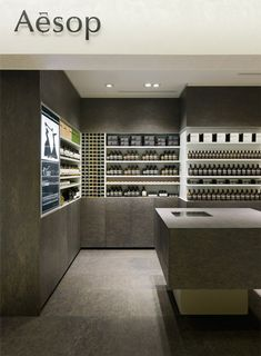 Aesop Shin-Marunouchi by Torafu Architects. Chipboard surfaces have been sanded and stained to look like marble. While associated as a rough material typically used in construction, as it is stained the wood adopts a stone-like appearance. The result is a distinct materiality.