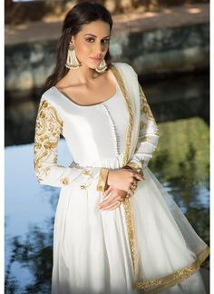 White and Gold Embroidered Dhupioni Silk Anarkali features a dhupioni silk anarkali santoon bottom and embroidered net dupatta. Zari lace and stone Pakistani Fashion Casual, Pakistani Dress Design, Pakistani Outfits, Indian Outfits, Indian Fashion, Korean Fashion, Indian Gowns, Indian Attire, Stylish Dresses