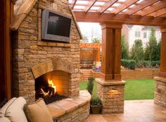 fireplace integrated with pergola, lighting on base