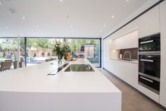 A modern kitchen was required by our client with clean lines to go into a carefully designed extension that had to meet listed building regulations. A glazed divide detail was used between the existing building and new extension. Kitchen Dining Living, New Kitchen, Modern Kitchen Design, Modern Kitchens, Kitchen Designs, Kitchen Ideas, Listed Building, Kitchen Images, Open Plan Living