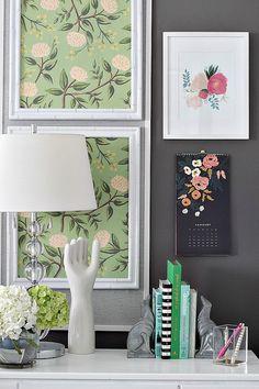Floral artwork above desk