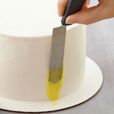 A spatula can be used to add texture and pops of color to a cake. Begin with an iced cake. Prepare your color palette of tinted buttercreams before starting this project. Thin consistency icing is key to prevent too much dragging. Spatula painting can be used sparingly or to decorate a whole cake.