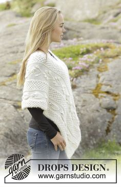 """Knitted DROPS poncho with different patterns in """"Alpaca"""" and """"Brushed Alpaca Silk"""". Size: S - XXXL."""