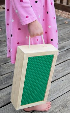 "This is a smaller version of our portable LEGO® storage box, which combines practicality with hours of fun! A perfect size for little laps (approximately 12"" x 6.5"" and 2 3/4"" high). It is great for traveling or everyday use. This carrying case is lightweight and easy for kids to haul around by the 1/4"" rope handle."