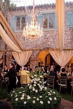 Clear tent and chandelier at @casafelizfl. Lighting by @keventlighting. Photo by Kristen Weaver. #casafeliz #wedding