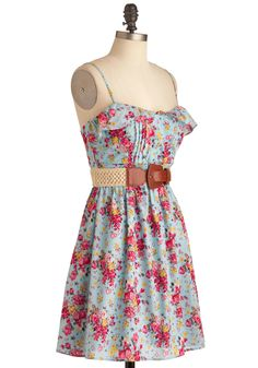 A pretty country dress paired with riding boots!