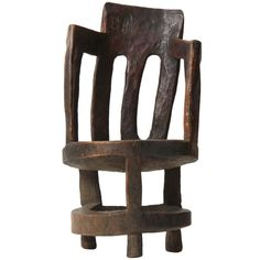 A hand-carved barrel-back armchair carved from a single tree section, with elongated, irregular piercings, and a circular seat on three legs with a ring stretcher - Wyeth