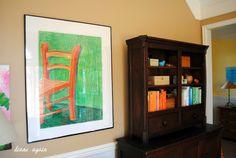 living room. gallery wall. black walnut cupboard.