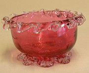 Victorian Cranberry Glass Salt having clear glass frilled decoration standing on shaped clear glass feet.  Cica 1900
