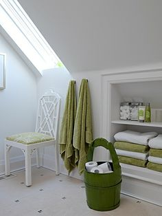 skylight; shelves in knee-wall; towel hooks; chair instead of stool; basket w/ toilet tissue supplies  --  Bathroom | Sarah Richardson Design