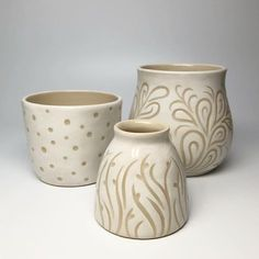 Some recently fired carved pots that I recently posted when they were greenware. Sweet and simple and finished! • #pottery #carvedpottery #wheelthrown #whitepottery #ceramics #smallpots #budvase #madeinaskutt