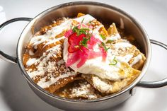 Thanksgiving Turkey Chilaquiles recipe by Richard Sandoval (use 1 C grated Oaxaca or Jack cheese and 1 C chopped or shredded turkey, 4 fried eggs are optional. Can also use store bought Salsa Verde)