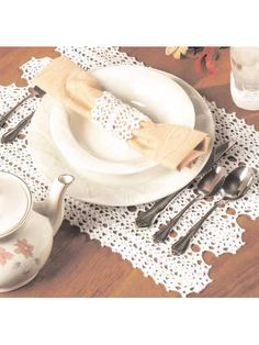 Our matching table ensemble is crocheted in white, but choose any color that complements your holiday table. Size: Place Mat: 11 x 18 Napkin Ring: in diameter. Coaster: 2 diameter base x 2 high. Crochet Placemat Patterns, Crochet Tablecloth Pattern, Crochet Stitches Patterns, Crochet Doilies, Crochet Kitchen, Crochet Home, Crochet Crafts, Free Crochet, Irish Crochet