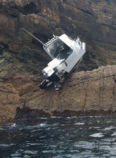 A boat on the rocks at Kawau Island
