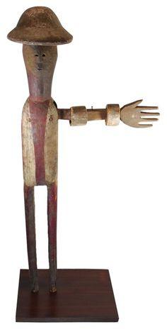 Looking for work - folk art wooden figure.
