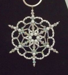 some gorgeous beaded snowflake ornaments here… Handmade Christmas Decorations, Beaded Christmas Ornaments, Snowflake Ornaments, Christmas Snowflakes, Handmade Ornaments, Beaded Snowflake, Beads And Wire, Bead Art, Bead Crafts