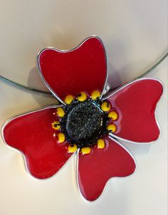 Poppy flower, free form mixed media, flat wire with resin.
