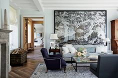 Comfort is the order of the day at the Locust Valley, New York, estate of former PR executive Emilia Fanjul Pfeifler, where deep upholstered furniture anchors a room that includes the original circa 1917 flooring and an antique mantelpiece sourced in Italy.
