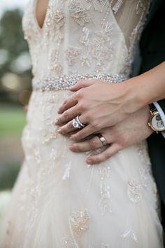 Bride & Groom Holding Hands, Showing Rings | Photo: Samuel Lippke Studios.