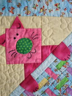 How fun is this cat peeking out?!? This could work great on an otherwise plain quilt to have a cat in one corner. Love that the paws and ears pop out.