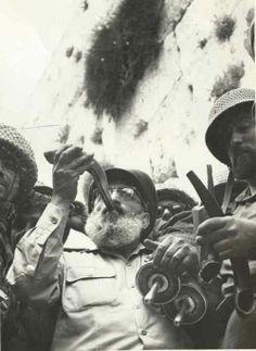 Rabbi Shlomo Goren blowing a Shofar after the liberation of the Kotel in Jerusalem, 1967.
