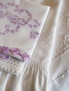 lavender embroidered linens... Every Christmas my husband's Grandmother gave all of her Grandchildren pillow cases like this.  She worked on them all year, a real treasure.