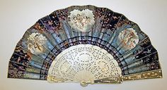 Vintage fan, late 19th century, French. Silk, ivory, sequins, metallic thread. 10 1/2 inches long. Signature: Sevilly. Metropolitan Museum of Art.