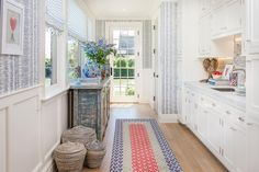 """The Summer Holiday House Design Show is taking place in a modern Hamptons home with a beautiful vista overlooking some of the prettiest views. Anne Tarasoff Interiors designed a """"Spring Fling"""" themed Butler's Pantry with a few red love and heart accents, which popped against our blue and white Danube Ikat wallpaper. For more information about #hhhamptons2016, visit www.holidayhousehamptons.com. The showhouse is open through July 26th! (Photography courtesy of Alan Barry Photography)"""