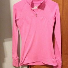 Under Armour pink long sleeve fitted shirt. Under Armour size small fitted long sleeve. Picture describes pretty well. Super cute shirt bought this at Scheels for my daughter she maybe wore 2x. Used but great condition. I can't see any stains. Under Armour Tops Tees - Long Sleeve