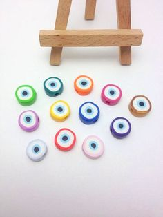 Evil Eye Beads, Baptism Decorations, Polymer Clay Evil Eye Beads, Jewelry Beads, Evil Eye Ornament, Μάτι, Pack of 10, 30 or 50 by JosCreationsGR on Etsy https://www.etsy.com/listing/192217769/evil-eye-beads-baptism-decorations