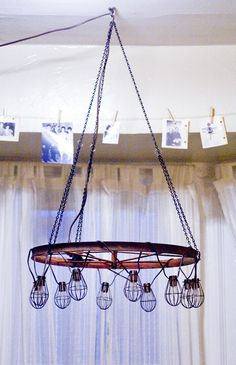 How to: Chandelier(using string lights, vintage wagon wheel & chain)