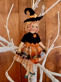 Halloween Paper Doll holding pumpkin, tombstone and skeleton tinsel garland. Handmade by NeedleandThreadLLC on Etsy. Retro Halloween, Halloween Make, Halloween 2018, Holidays Halloween, Halloween Ideas, Halloween Decorations, Paper Doll Craft, Doll Crafts, Paper Crafting