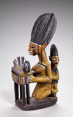Africa | Female figure with child and bowl | Early to mid 20th century | Wood and paint