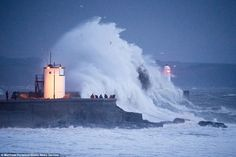 Here it comes: Large waves crash over the harbour wall at Porthcawl, South Wales, as storm Frank hits the UK bringing torrential rain and winds of up to 80mph. The storm will sweep across England, Wales and Scotland today - bringing further misery to flood-ravaged homes