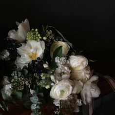 Spring bouquet in all white featuring tulips, viburnum berries, ranunculus and eucalyptus. Hand crafted by stemsbrooklyn.com