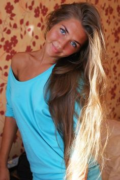 Soft dark blonde hair on a girl that's pretty darned cute!  Oh to be that young again!