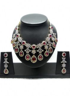 27f9b17bd33 White American Diamond Studded Red Color Necklace set over Silver And  Golden Electroplated base.
