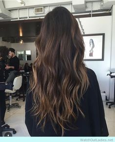 Shadowed brunette roots and bronde hints